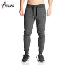cotton yellow workout pants Canada - Wholesale- 2017 Men full sportswear Pants Casual Elastic cotton Mens Fitness Workout Pants skinny Sweatpants Trousers Jogger Pants