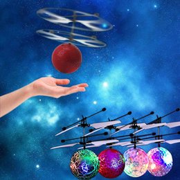 ufo sensor NZ - Magic Electric Aircraft Flying Ball Helicopter Infrared Induction Sensor LED Light Epoch Kids Teenagers UFO Toys