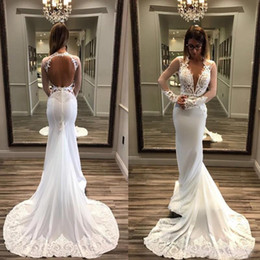 plunging neckline mermaid wedding dresses Australia - Sexy Long Sleeves Mermaid Wedding Dresses 2020 Plunging Neckline Backless Lace Appliqued Bridal Gowns White Bride Dress