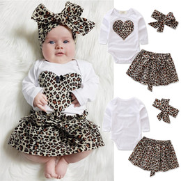 Hair Band Girl Kids Australia - kids clothes romper+Skirt+Hair band 3 Piece Sets kids designer clothes girls long Sleeve T-shirt Love heart romper leopard Skirt JY203