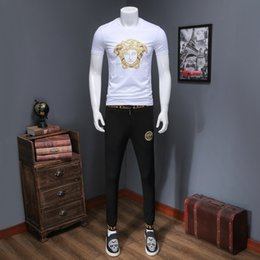 Wholesale New Fashion Tide Mens Wear Embroidery Short Sleeves T shirt And Trousers Suit Korean Edition Youth Two Piece Set309