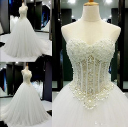 dropped wedding dresses NZ - Plus Size 2020 princess Ball Gowns Wedding Dresses Sweetheart Pearls Beaded Sleeveless Illusion Lace-Up Back Bridal Gowns vestido casamento