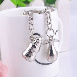 silver wedding giveaways Australia - Hot Sale metal pacifier and feeding bottle key chain favors baby shower souvenirs, party giveaways 500lots