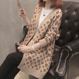 Venta al por mayor de 2018 Nueva marca Otoño Invierno Moda Femenina suéter de lana de manga larga suelta tejer suéter Mujeres de punto femme suéter