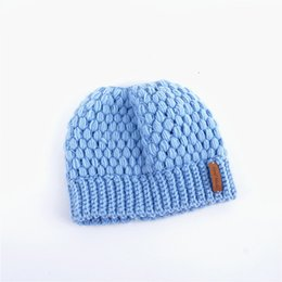 c617a23d0cf Women Ponytail Hat Autumn Winter Warm Knitted Horsetail Caps Fashion Ladies  Hollow Out Hats Crochet Designer Knitting Caps Beanie gifts hot