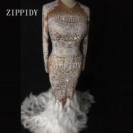 Dresses Stones NZ - Sparkly Rhinestones Feather Full Stones Long Big Tail Sexy Nude Dress Nightclub Bar Prom Birthday Celebrate Show Costume Dresses