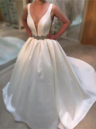 Empire Waist Crystal Beading Australia - Sexy Deep V neck Cheap Wedding Dresses Bridal Gowns 2019 Open Back Satin High Quality Designer Crystal Beaded Ribbon waist Wedding Gown
