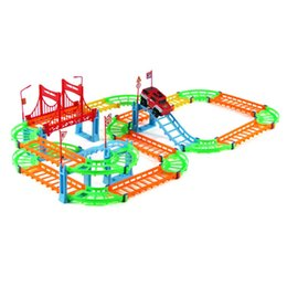 Discount cars toys track - Magical Railway Road Track Toys DIY Variety Electric Speed Car Train Model Assembly Racing Rail Tracks Car Toy For Child
