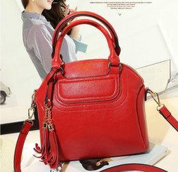 $enCountryForm.capitalKeyWord NZ - Spring and summer best-selling new leather women's bag Europe and the United States red hand tassel shell elephant grain cowhide single-shou
