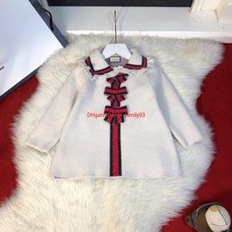 $enCountryForm.capitalKeyWord NZ - Girls blouses kids designer clothing autumn girls A word long coat cashmere knit pullover fashion bow decoration2019