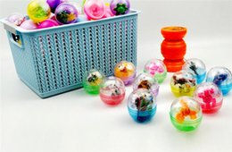 $enCountryForm.capitalKeyWord Australia - JUXU Easter transparent plastic twisted egg toy cube dinosaur car Mixed toy machine game machine gift ball