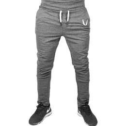 Slim fit trouSerS online shopping - New Men Style Casual Fitted Gym Pants Slim Fit Embroidered Stretch Urban Wind Sport Pants Straight Trousers