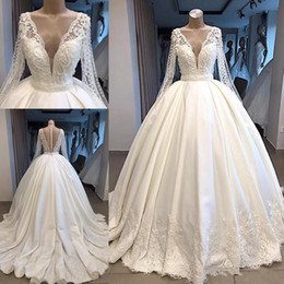 Plunge Wedding Dresses UK - Modest Long Sleeve Wedding Dresses 2019 New Appliqued Lace Beaded Wedding Dress Plunging V Neck Dubai Arabic Bridal Gowns