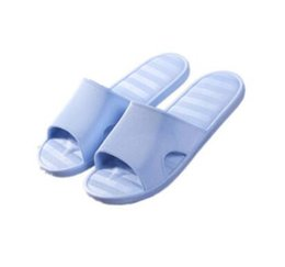 a2772ae4fb744 Free shipping home plastic soft bottom slippers men and women solid color  striped sandals and slippers simple summer bathroom shower couple