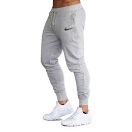 Venta al por mayor de 2018 Nuevos Hombres Joggers Marca Pantalones Masculinos Pantalones Casuales Pantalones de Chándal Hombres Gimnasio Músculo Algodón Fitness Entrenamiento hip hop Pantalones Elásticos