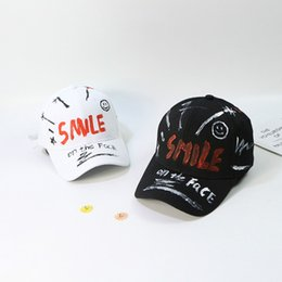 fe890f6ef1a Hand Painted Doodle Baseball Cap Smiley Cap Simple Fashion Hip Hop Cap  Black and White Letter Pattern Hat