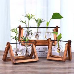 Vintage Creative Hydroponic Plant Vaso trasparente Struttura in legno Coffee Shop Room Vetro Tavolo pianta Bonsai Home Decor Flower Vase in Offerta