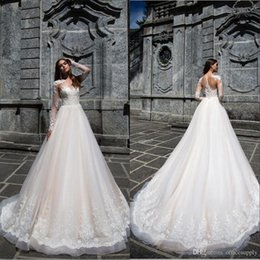 Sheer wedding dreSSeS nude online shopping - 2019 Lace Wedding Dresses Mermaid Bridal Gown With Long Sleeves Sheer Back Covered Button Ivory Nude Court Train Custom