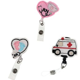 rhinestone badge reels UK - 10pcs lot Mixed Design Emergency Car RN Heart Retractable Badge Reel Felt Medical Nurse Gift Ambulance Stethoscope ID Name Badge Holder