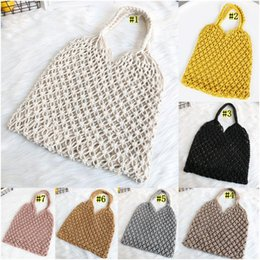 rope net wholesale UK - Beach Woven Bag Mesh Rope Weaving Tie Buckle Reticulate Hollow Straw Bag No Lined Net Shoulder Bag DHD632