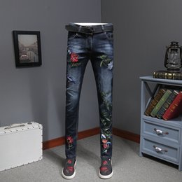Wholesale flowered skinny jeans for sale - Group buy Vaqueros Skinny Men s Flower Embroidery Jeans Fashion Slim Distressed Denim Pants Erkek Jean Pantolon Moda Hombre