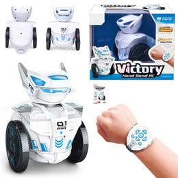Venta al por mayor de Juguetes para niños Seguir este remoto inteligente 2.4G desgastado Robot juguetes inteligentes reloj remoto robot de control Programación Educación LED Música RC