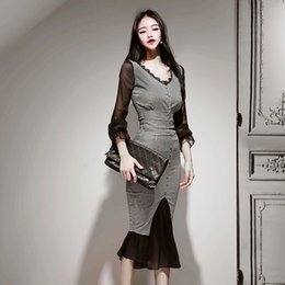 Korean top sKirts online shopping - Korean version of the latest office lady fashion plaid sexy stitching top slim fishtail half skirt suit
