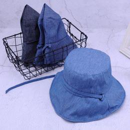 f414ea0b7c009 2018 Summer Fashion Women Floppy Denim Bucket Hat With Big Bowknot Wide  Brim Sun Hats Beach Foldable Neck UV Protection Caps