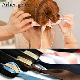 $enCountryForm.capitalKeyWord NZ - Arherigele 1pcs Magic Tools Foam Sponge Device Donut Bun Maker Hairstyle Girls Women Hair Bows Band Accessories Ribbon Headband