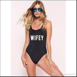 08b3c41cbe5 WIFEY New Letter Swimwear Women One Piece Sexy Swimsuit High Cut Beach Wear  Bodysuit Back Cross Bathing Suit biquinis Black Blue YWXK