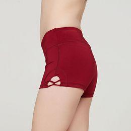 $enCountryForm.capitalKeyWord Australia - Summer new ladies tight skin peach hip yoga shorts spinning bike cross hollow sports running shorts