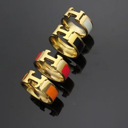 Famous aFrican americans online shopping - Price Famous Brand Gold Color L Stainless Steel H stamp Rings Black and white red orange drop oil H ring For Women