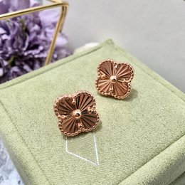 Designer Copper Jewelry Australia - Exquisite copper plated glossy four-leaf designer jewelry women earrings clover car flower carved earrings stud earrings