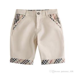Erkek pantolon 2019 INS YENI Moda çocuklar yaz yeni stiller ekose Pantolon yüksek kaliteli pamuk Eğlence tarzı Erkek Beş-noktalı Pantolon ücretsiz kargo