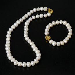 Discount natural pearl beads mm - Natural pure With Regular design Milky yellow Near Round 9-10 mm beads Pearl Necklace and Bracelet suit.