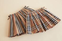 Preppy style girls plaid skirt 2020 new children Bows belt elastic stripe skirt brand kids clothes girls cotton lattice pleated skirt P0181 on Sale