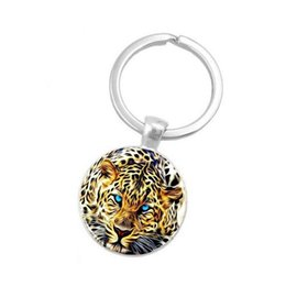 Chinese  2019 new leopard photo keychain, Tibetan silver crystal keychain, glass cabochon alloy keychain, gift for family, Christmas gift manufacturers