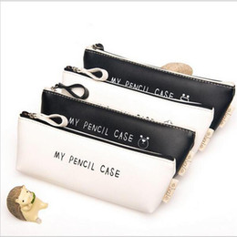 $enCountryForm.capitalKeyWord Australia - Wholesale-Best Deal Triangular My Pencil Classic Black And White Color Waterproof PU Leather Cosmetic Bag Storage