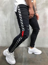 asian cotton pants Canada - 01Mens Jeans Streetwear New Casual Style Ribbon Hole Pencil Pants Slim Zip Asian Size S-3XL Free Shipping