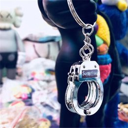 Discount cool keychains - SUP Keychain for Men Women Handcuffs Shape Car Key Chain Brand Key Ring Cool Bag Accessories