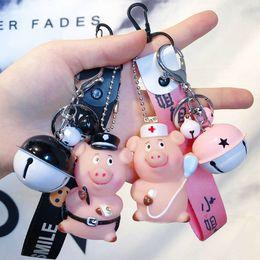 $enCountryForm.capitalKeyWord NZ - Cartoon Cute Animal Career Pig Keychain Wrist Band Doll Bell Key Holder Women Car Purse Pendant Key Chain Trinkets Gift