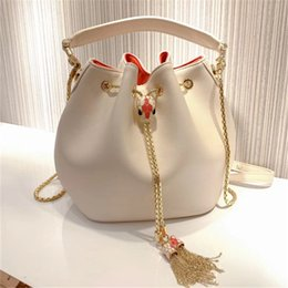 $enCountryForm.capitalKeyWord UK - Art2019 Cowhide Python Skin Enamel Snake Bucket Package Woman Tassels Single Shoulder Messenger Handbag