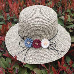 5659caa9126 Women Girls Beach Solid Color Three Decorative Flowers Lace-up Straw Hat  Wide Large Brim Foldable Sun Hat Beach Cap Visor