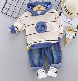 kids korean hat winter 2019 - Fall 2019 New Kids Suit Korean version of Smiling Face Stripe Hat T-shirt + Jeans Two-piece Suit Factory Direct Selling