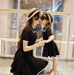 $enCountryForm.capitalKeyWord Australia - Mommy and daughter matching outfits summer girls pearls buckle black princess dress boys stripe lapel short sleeve polo shirt F8640