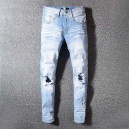 $enCountryForm.capitalKeyWord Australia - Designer Fashion Streetwear Men Jeans Light Blue Retro White Wash Destroyed Ripped Jeans For Men Slim Fit Frayed Hole Hip Hop Robin Jeans