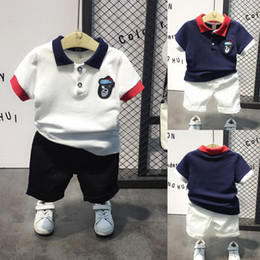 Prussian Clothing Australia - 2019 new hot-sale products Boys T-shirt shorts set Fashion childrens clothes Sleeve lapel in cartoon solid color The baby shirt