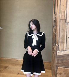 6ea03eb02e56d Hepburn style black white bow sash knitted brief peter pan collar dress  French girl mini dress lady 2019 spring Korean