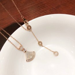 Love Skirts NZ - Natural White Fritillary Skirt Necklace Imported 925 sterling silver plated 18k gold-encrusted fan-shaped white shell