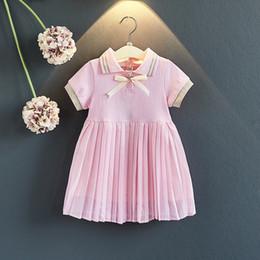 71359f481 Niñas cuello polo corbata anudada algodón volantes vestidos Una línea de  manga corta de verano de calidad rosa blanco niño niñas ropa trajes 3-8T